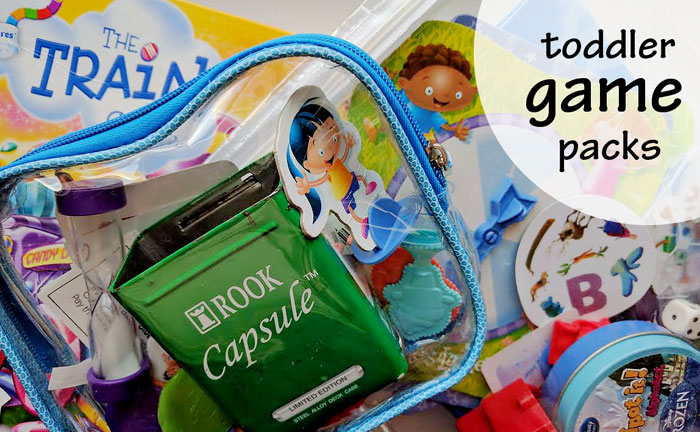 Packs of pieces from multiple games for toddlers to explore keeps them more interested than they'd be with a single game | Running With Spears #games #toddlers #parenthacks